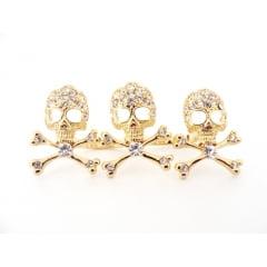 Anel dourado de 2 dedos com caveirinhas e strass