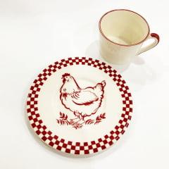 Xicara de chá galinha vermelha